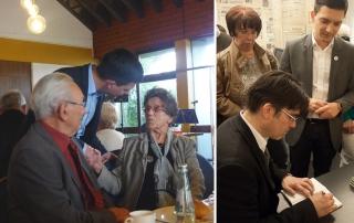 Sebastian Greiber gratuliert zum 100. Geburtstag beim Seniorennachmittag in Schaffhausen und freut sich über die persönliche Widmung von Patrik Feltes bei der Buchvorstellung im Abteihof Wadgassen.